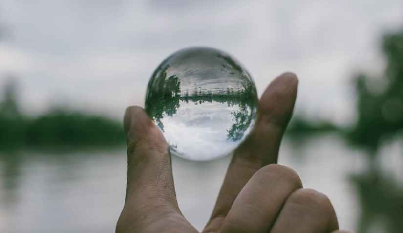 close up photography of person holding crystal ball